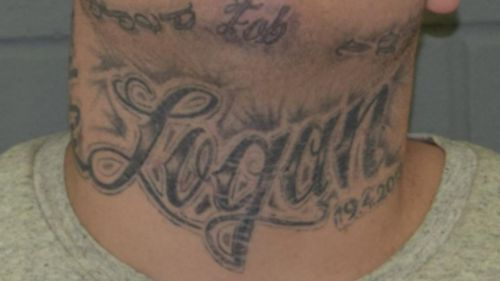 """Jones has several distinct tattoos, including on his neck which bears the name """"Logan'. (SA Police)"""