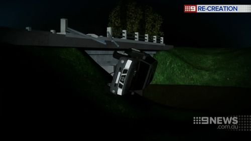 The car plummeted off the bridge and landed on its roof. (9NEWS)
