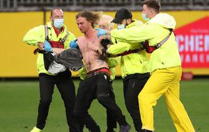 WA pitch invader charged, facing $50k fine after running onto AFL match deemed COVID-19 quarantine zone
