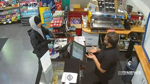 A service station worker was held at gunpoint for a packet of cigarettes.