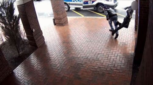 """After """"assessing the situation as fast as he could"""", Bill stuck out a leg, tripping the 18-year-old suspect and enabling police to catch up and arrest him. (Columbus Division of Police)"""