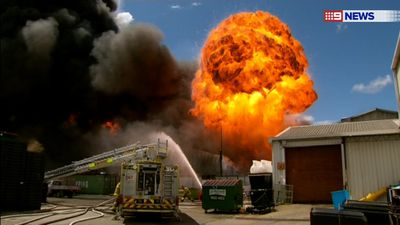 One hundred firefighters from fire stations across Sydney have battled a massive blaze which has engulfed a factory in Revesby in the city's south-west. These are the best photos. A ball of fire shoots up from the fire at a Revesby warehouse. (9NEWS)