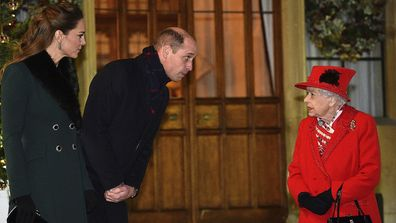 The Queen and Prince William meet in the quandrangle at Windsor Castle.