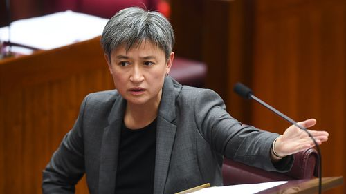 Labor Senator Penny Wong reacts during debate on the Nauru bill.