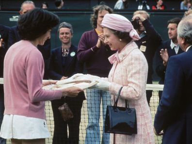 Queen Elizabeth II presents the trophy to British tennis player Virginia Wade after she won the Women's Singles competition at Wimbledon, 1st July 1977.  (Photo by Hulton Archive/Getty Images)