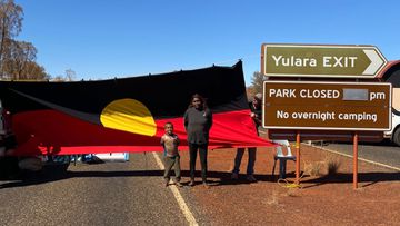 Locals created a blockade at the entrance to Uluru-Kata Tjuta National Park today.