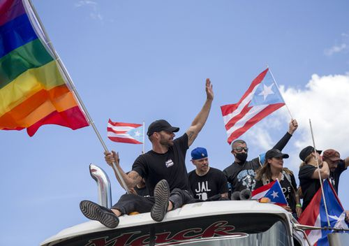Ricky Martin, flying a gay pride flag, joins a protest to demand de resignation of Governor Ricardo Rossello from office, in San Juan, Puerto Rico.