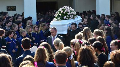 "<p _tmplitem=""1"">Family and friends wore the traditional colours of mourning to say their farewells to Melbourne teen Masa Vukotic. </p><p _tmplitem=""1""> But among the mass of black it was the whispers of pink that stood out — Masa's favourite colour.  </p><p _tmplitem=""1""> </p> (Photos: 9News and AAP)"