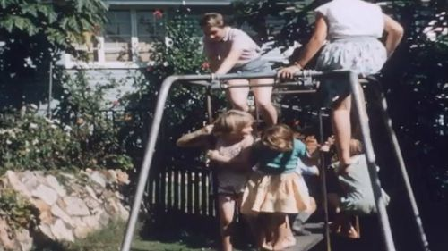 The Bennett's swingset wasn't quite big enough for all of his children. Picture: State Library of Queensland Reel Rescue