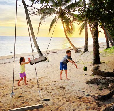 Kids playing on a tropical beach