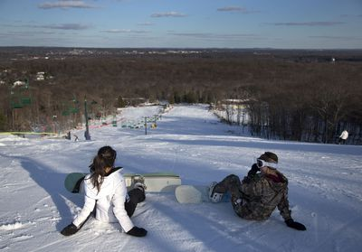 January 27 - The warmest December on record in New Jersey meant skiers and snowboarders had to wait until colder temperatures moved in midway through January with a polar vortex. Here Snowboarders take a break before descending a hill at Campgaw Mountain Ski Area, in New Jersey. (AAP)