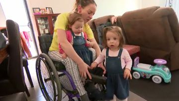 Mum with paraplegia raising twins with help from unique program