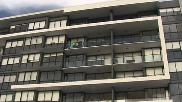 Mum killed in apartment plunge 'may have been climbing between balconies'