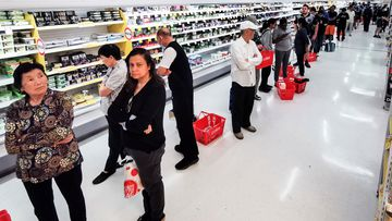 People queueing for a delivery of toilet paper, paper towel and pasta at a Coles supermarket, in March 2020.