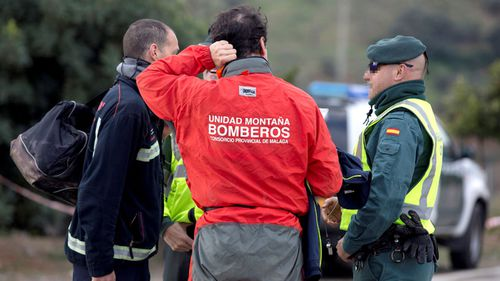 Rescuers of the young boy at the site of the deep borehole in southern Spain.
