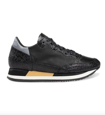 """Add a splash of sparkle to corporate dressing with these sophisticated sporty kicks, guaranteed to make a style statement – inside and outside the office. Team with a skater skirt and graphic t-shirt or tailored trousers, leather jacket and a classic white shirt for maximum impact. <br> Philippe Model Low Donna sneakers in black glitter, $669. <a href=""""https://www.modesportif.com/shop/product/philippe-model-low-donna-in-black-glitter/"""" target=""""_blank"""">Modesportif.com<br> </a>"""