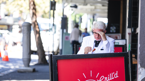 Man dress as KFC's Colonel spotted eating healthier fried chicken at a Grill'd store.