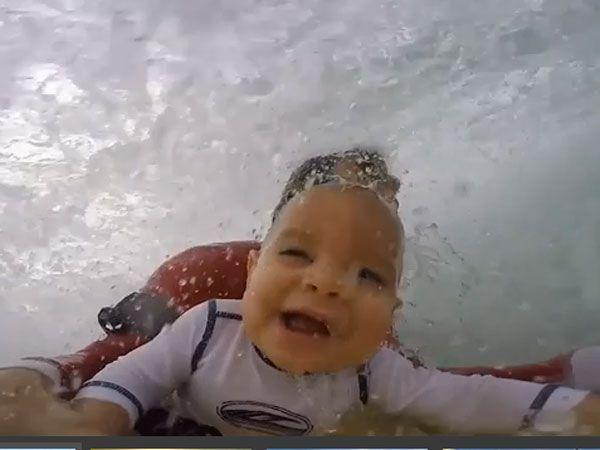 Baby bodyboarder shoots the curl