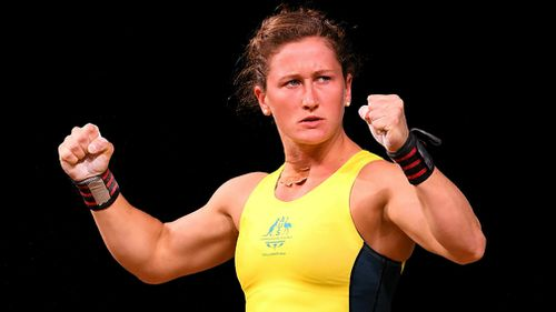 Tia-Clair Toomey gestures after a successful lift in the Commonwealth Games. (AAP)