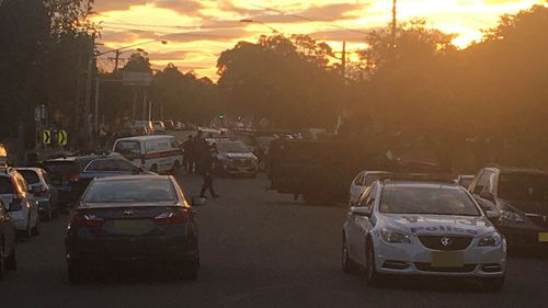 Armed police at a property in Punchbowl in Sydney's south-west. (Tiffiny Genders/Twitter)