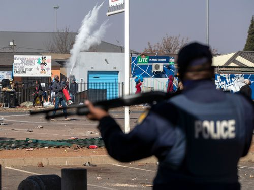 Police fired rubber bullets at dozens of looters as they ran from a mall with everyday items, while other shops in the vicinity were set ablaze.