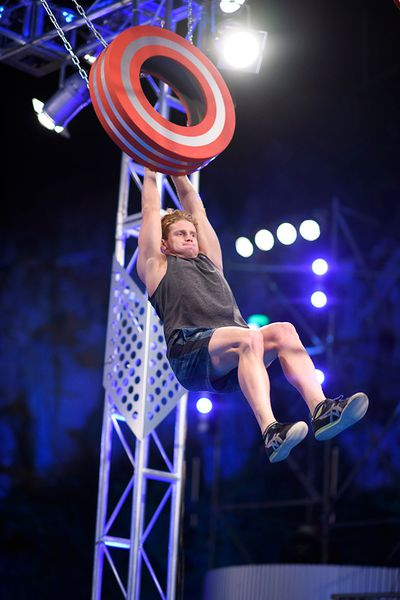 Olympic athlete Ryan Fisher taking on the Tyre Swing.