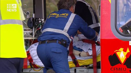 She was taken to Port Macquarie Base Hospital with serious lower leg injuries.