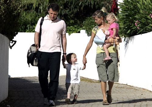 Gerry and Kate McCann, the parents of missing girl Madeleine McCann, walk with their twins Sean and Amelie on May 15, 2007, in Praia da Luz, Portugal.