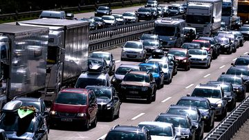Columns of vehicles crowded together on a motorway in Europe.