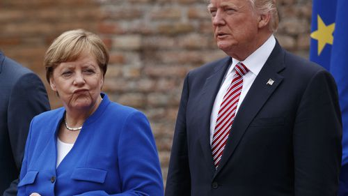 German Chancellor Angela Merkel and President Donald Trump pose for a photo with G7 leaders on May 26, 2017, in Italy. Photo: AP