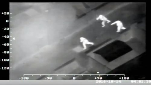 Police footage shows Moore being chased by two police officers. (AAP via Greater Manchester Police)