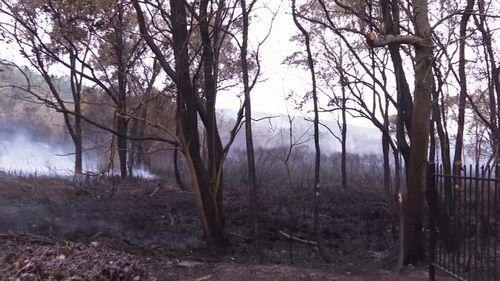 The fire came within metres of homes.