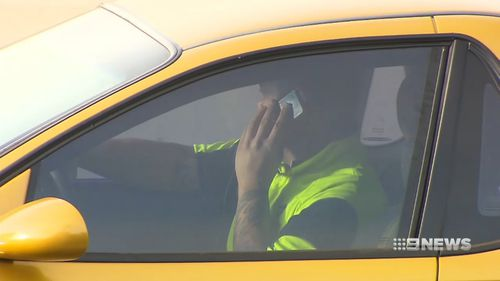 The Queensland Transport Minister has admitted laws to deter motorists from using mobile phones while driving are not effective.