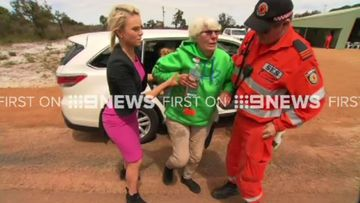 9NEWS crew finds missing woman alive after night lost in bush
