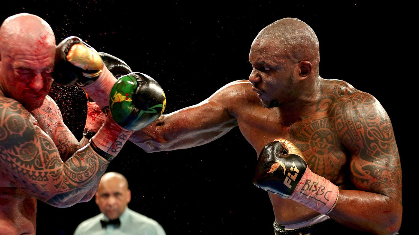 Dillian Whyte, right, sends a right to Lucas Browne in the WBC Silver Heavyweight Championship contest