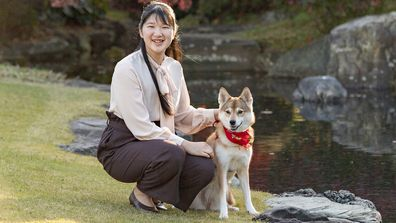 Japan's Princess Aiko, daughter of Emperor Naruhito and Empress Masako, poses for a photograph with her pet dog Yuri at her residence in Tokyo on Nov. 22, 2020. Princess Aiko celebrates her 19th birthday on Tuesday, Dec. 1, 2020