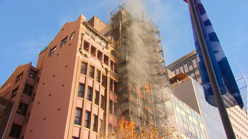 Lockhard Chambers on Macquarie Street erupted in flames only days after its cladding was removed. Picture: 9NEWS
