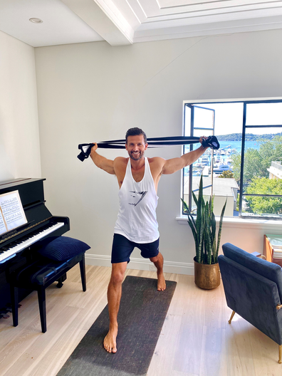 Tim Robards home workout with a towel