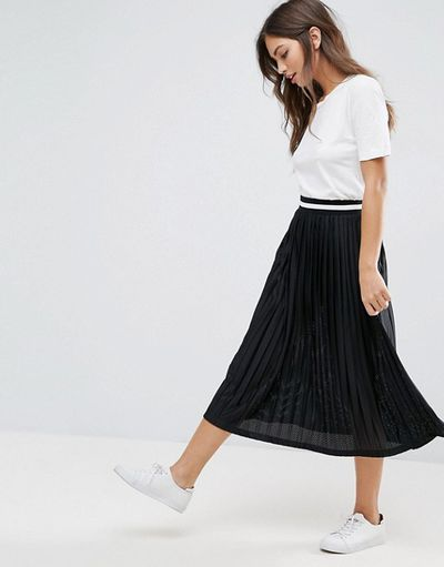"<a href=""http://www.asos.com/asos/asos-pleated-midi-skirt-with-sports-tipped-waistband/prd/7596576"" target=""_blank"" draggable=""false"">ASOS Pleated Midi Skirt with Sports Tipped Waistband, $56.</a><br /> Swinging pleats, machine washable, wipe-off polyester and comfy sports-luxe waistband."