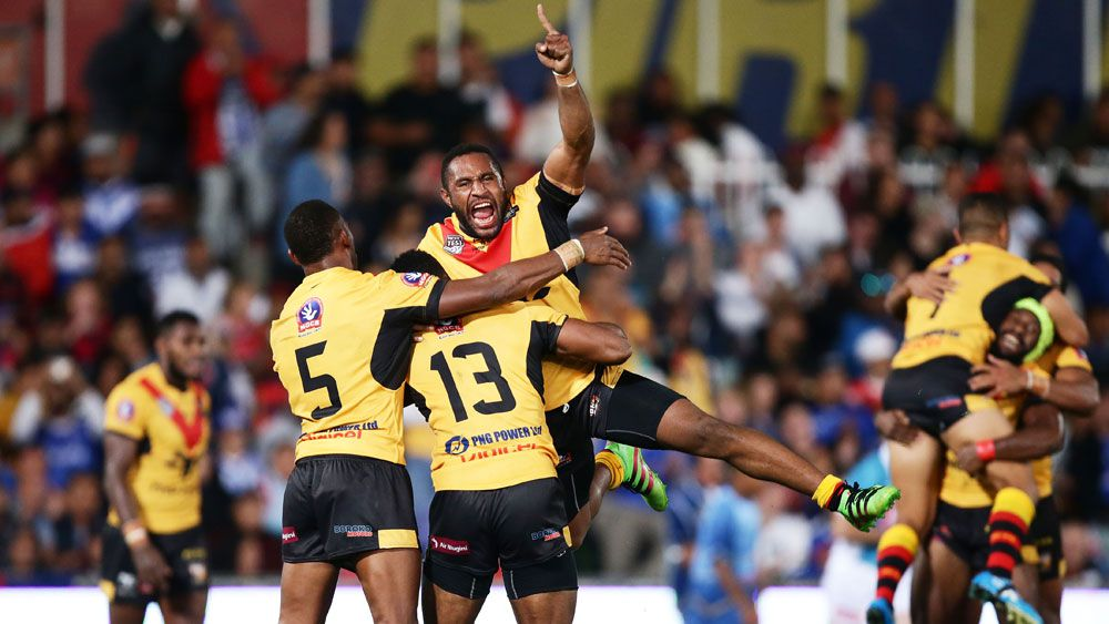Papua New Guinea players celebrate after beating Fiji. (Getty)
