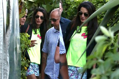 Amal kept it (a little too?) casual in shorts and a neon skull top for the daytime event.