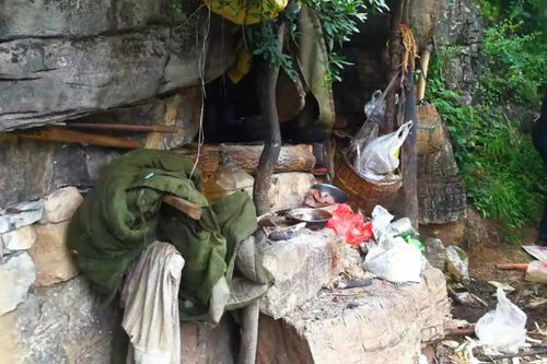 The entrance to Song Jiang's cave hideout. A drone spotted some rubbish outside the cave while flying above Jiang's mountain home.
