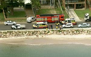 Woman rushed to hospital after being found face down in the water at beach in Sydney's south