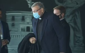 George Pell heckled outside Rome apartment ahead of possible Vatican meeting with Pope Francis