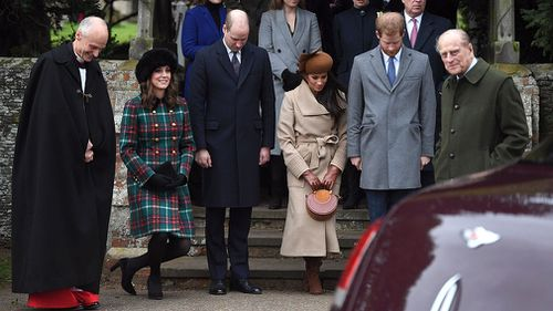 The young royal family and Markle bow and curtsy as the Queen arrives for mass. (AAP)