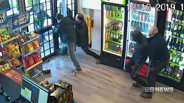 A Melbourne grandfather has risked his life, fighting off armed robbers at his family bottle shop while police took almost half an hour to arrive.