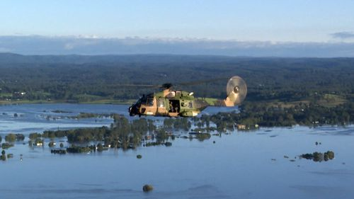 A Royal Navy Taipan helicopter crew extracted the campers. NSW Floods