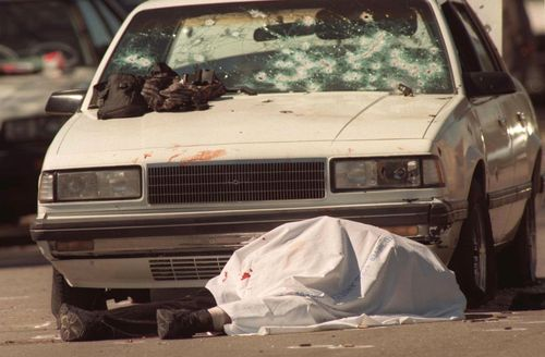 Emil Mătăsăreanu lies dead in front of a car peppered with bullet holes during a botched bank robbery and subsequent shootout in North Hollywood.