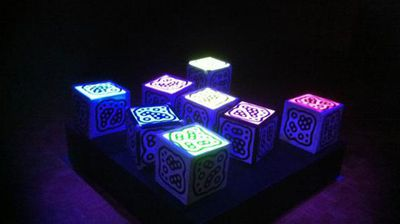 "Continuing with the ""night time playground"" theme is Australian artist TOby K's BeatDice.  Illuminated sensor cubes, or 'BeatDice', are manipulated to mash-up diverse musical sounds and rhythms.  As people create musical compositions with the cubes, the installation responds by creating a visual pulsating light artwork."