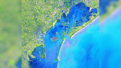 """Four hundred bridges cross the labyrinth of canals that form the 120 islands of Venice, situated in a saltwater lagoon between the mouths of the Po and Piave rivers in northeast Italy. All traffic in the city moves by boat."" (NASA/METI/AIST/Japan Space Systems, and U.S./Japan ASTER Science Team)"